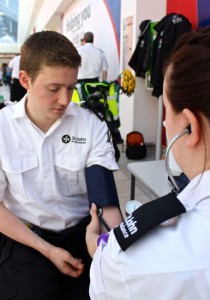 Steven has his blood pressure checked by Rose at the 2014 Market Green demo.